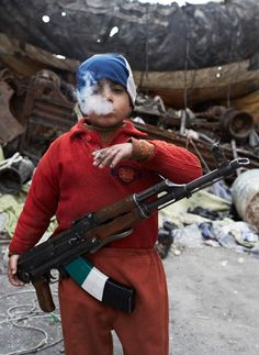 Child rebel, Syria. Who is the photographer?