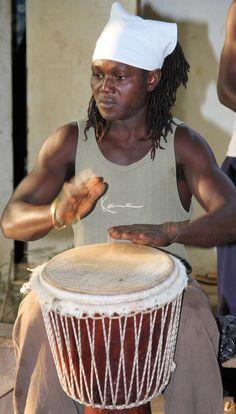 Man on drum. Tanji, The Gambia (@Brimstone Dreams)