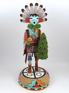 "Morning Singer (Talavai) Kachina Holding a Spruce Bough and a Bell, Hand Carved from Cottonwood Root and Hand Painted. 10.5"" Doll Height, 12"" Total Height"