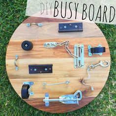 DIY BUSY BOARD | cheese board + locks, latches, hinges, hooks, wheels etc + a whole lot of muscle! | @oliviasfoster