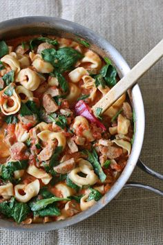 Grab your skillet! This creamy sausage and spinach tortellini will be a family fave.
