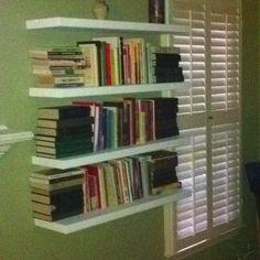 Floating bookshelves in living room.