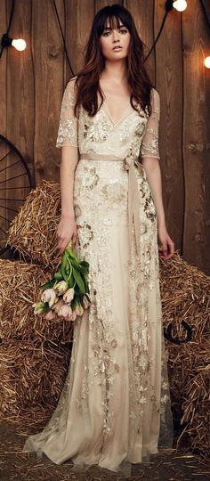 Jenny Packham Spring 2017 Faith champagne-hued wedding dress with net overlay and embroidered, gold-sequined flowers, plus a dark beige grosgrain ribbon