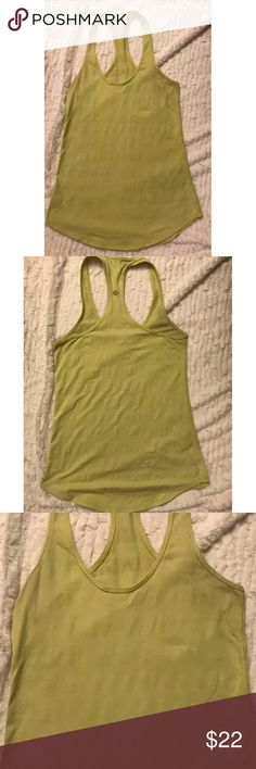 Lululemon Yellow Ribbed Racerback Tank Lululemon yellow ribbed racerback tank in size 8! There's only a bit of pilling on the outside, but there's more pilling on the inside of the tank which no one can see when you're wearing it! Overall decent condition, and price reflects it! Not a bad deal for this! 😎 bundle to save! lululemon athletica Tops Tank Tops