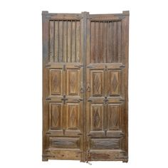 Pair of tall Spanish Colonial entrance doors. Still has it's original metal hardware. The aged look that it carries offer a tremendous amount of history. Shows wear that's consistent with age and use.