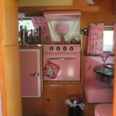 Pink vintage trailer I like the back splash behind the stove and the leather seats