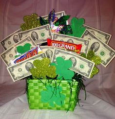 St. Patricks Day raffle basket!  10, $2 bills, pin wheel, 1000 Grand bar, Pay Day, foam clovers. Fundraiser Themes, Fundraising Ideas, Theme Baskets, Gift Baskets, St Pattys, St Patricks Day, Avon 39, Basket Raffle, Resident Retention
