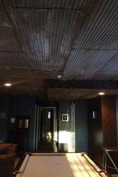 Corrugated Tin Roofing Refurbashed as Interior Decor for a Ceiling