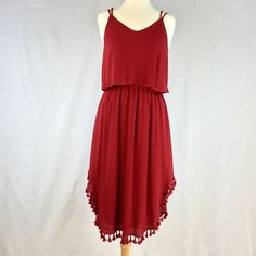 ‼️CLEARANCE‼️Tassel My Hem Dress. Burgundy, top overlay, dress with double spaghetti straps that criss-cross in back. Featuring a cute tassel hem.   100% Rayon  📌***Multiple Sizes Available! Tap Your Size Below 👇***📌 Entro Dresses