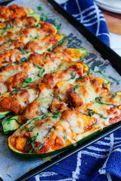 Low Carb Cheesy Sauasage Stuffed Zucchini Pizza Boats | www.asaucykitchen.com