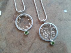 Two pendants, silver 18ct gold and peridots. Diana Greenwood