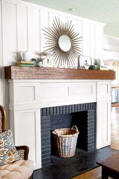 fireplace redo after with white wood trim, rustic mantelshelf and black-painted firebox - Decoration for House Fireplace Redo, Decor, Home Fireplace, Fireplace Design, Home Remodeling, Fireplace Decor, Fireplace Makeover, Home Decor, Fireplace Surrounds