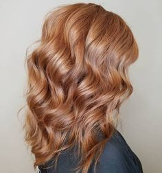 Medium Wavy Strawberry Blonde Hairstyle