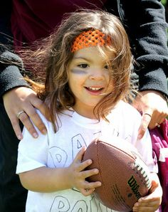 "Deyalisse Rauscher, 3, is ready to go with her homemade shirt that says ""Dawg Pound"" at the Browns Family Fun Day at Gordon Square Early Learning Center. (Lisa DeJong/The Plain Dealer)"
