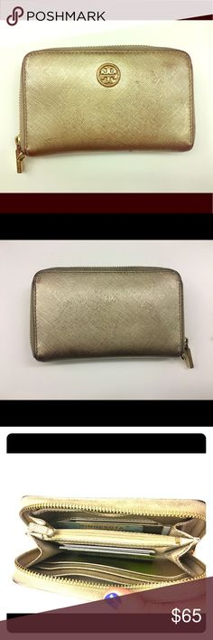Tory Burch Robinson Continental Zip Wallet 1 year old Tory Burch gold metallic continental zip wallet. A bit worn on the gold emblem, but other than that it is in perfectly good shape. The size fits in any bag and is well-suited for any circumstance. Tory Burch Bags Wallets