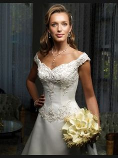 This beautiful Casablanca gown was in the running for my wedding dress. It ALMOST won but I picked a Private Label by G gown instead. It features a scalloped sweetheart neckline with off-the-shoulder straps. It has  basque waist, French bustle, A-line skirt, and beautiful bead work on the bodice. You can see why I almost chose it!