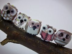 tiny foreset owls in purples