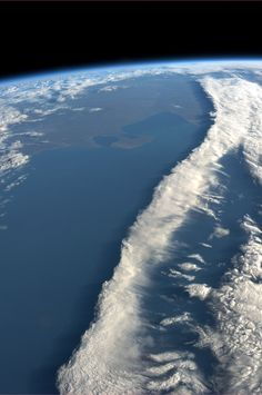 A ribbon of clouds intersecting the coast of Argentina. Taken August 7, 2013.  KN from space.