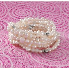 """GODDESS BRACELET  The enchanting Goddess Bracelet boasts seven stretchy strands of Pearls and Sterling Silver, making it the ideal statement piece for your date-night outfit. Throw it on with a classic black dress for a polished, Audrey Hepburn-inspired look. 8"""" length."""