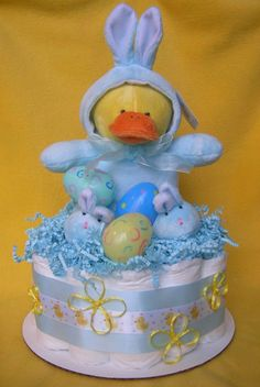 Adorable Easter Mini Diaper Cake with plastic eggs and a duck dressed up like a blue bunny.  Perfect Easter gift for a new baby on the way.  Made by GK Babies on etsy.com $24.99