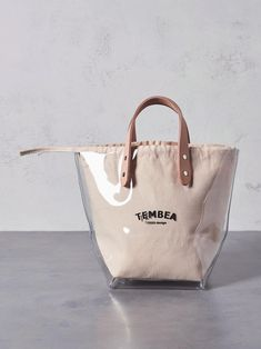 Even though the name sounds flimsy the bags are quite the fashion and come in many materials plaid and tapestry; Transparent Bag, Summer Bags, Casual Bags, Pouch Bag, Fashion Bags, Fashion Fashion, Fashion Women, Bag Making, Shopping Bag