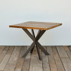 Reclaimed wood table with hand welded steel pedestal base in your choice of size and finish