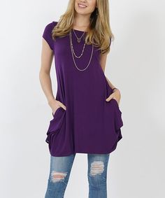 Enhance your contemporary collection with this curve-skimming tunic made with a touch of stretch and featuring convenient side pockets. Hidden snaps can be engaged to add a ruching effect and more curved hemline.