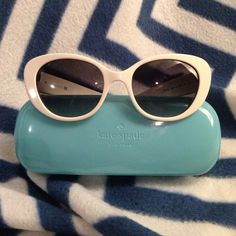 Kate Spade ♠️ White Sunglasses  White Kate Spade retro sunnies, complete with its hard case. There is a tiny nick on the inside frame (pictured), and very tiny nicks on each lens that do not photograph well and do not affect sight at all. These are my go-to driving sunglasses! Open to reasonable offers made through the offer button! kate spade Accessories Sunglasses