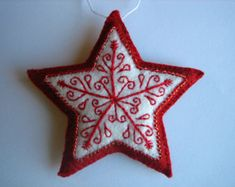 turquoise embroidered felt star ornament by nikkissglein on Etsy