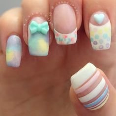Colorful candy colored French tips. Combine crazy designs such as stripes, polka dots and flowers into your French tips as well as adding heart and ribbon embellishments on top for effect.