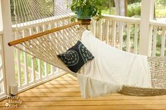 Hammock on porch OR deck. Am envisioning loads of potted plants, etc., in the background... I'd like to do this for the third floor deck... a place to read, imagine, nap, and forget I live in a city! Am considering adding a pergola, but may want full sun... need to think. :)