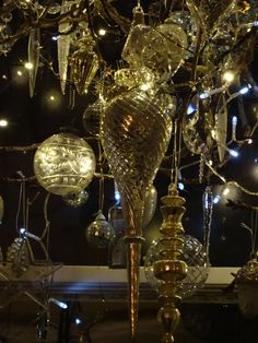 The Winter Branch 2014. A beautiful glass teardrop is this years addition to the Winter chandelier created in our bay window.