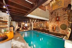 """The living room contains a massive 30,000 gallon, eight-feet-deep swimming pool equipped with a swing. Today, of course, the inclusion of a pool in a living room would never be approved. But since this pool was built in 1975 it has been """"grandfathered in"""" and allowed to stay."""