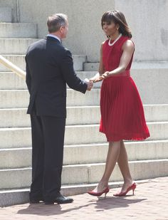 MICHELLE OBAMA 04—19—13 Annapolis, MD What - Crimson pleated Michael Kors dress Where - A bill signing ceremony at the State House