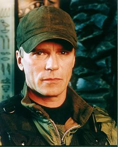 "Colonel Jack O'Neill, Stargate SG-1.  ""It's always suicide-mission this, save-the-planet that. No one ever just stops by to say 'hi' anymore."""