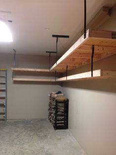 Garage shelves using 2x4s, plywood, and wrought iron brackets and channel. We used Sherwin Williams Balanced Beige paint on the walls.
