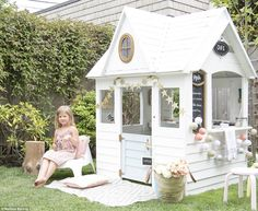 Hours of fun: One of Melissa's three children takes a seat outside the charming back garden cafe, which boasts a counter for selling homemade lemonade and baked goods. A wall-mounted chalkboard and hanging signs are both sweet additions