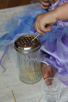 What an awesome idea!  Adding to it:  you could recycle spice jars to cut on the cost also, I thought you could have four different containers, then use a package of colored toothpicks and make it a sorting activity as well!