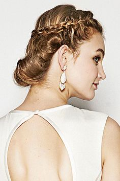 For a goddess-like aura, add twists to your braided updo.