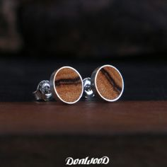 Olive wood embedded in a silver earring by DonWood.cz