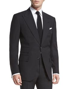 "Tom Ford ""Windsor"" base solid two-piece suit. Peak lapel; hand-finished double-stitched silk button hole. Structured shoulders. Two horn-buttons down front. Front flap pockets, ticket pocket, and hand"
