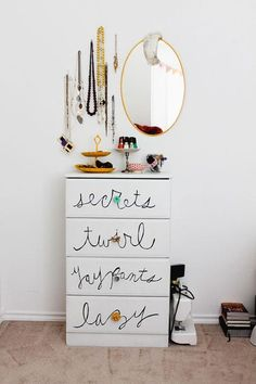 Cute dresser idea. I like the mirror and jewelry placement too.