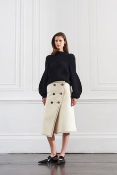 How to layer like an expert: six styling tricks from the resort 2016 collections: A bulky sweater tucked into a wrap slit skirt (with flats!) at Victoria Beckham.