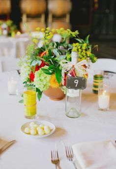 DIY wine bottles for table numbers, bright centerpieces // Milou And Olin Photography