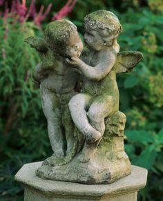 .statuary always beautiful when tucked into a garden, patina so pretty!