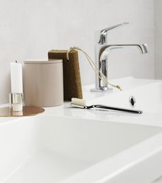 the double basins leave ample space for storing bits and pieces close at hand bits and pieces furniture