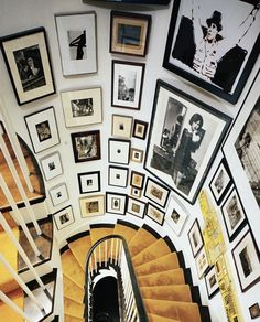 I Need Your Help! Eclectic Gallery Walls - laurel home | wonderful gallery wall on a curved stairwell with gold carpet