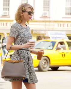 There are many things I like about this photo... First, adorable dress. Second, she's carrying two drinks. And well so on...