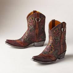 """JAZMIN BOOTS--Evidence of the artist's touch is revealed in each fiery, hand-tooled blossom on our exclusive floral leather boots by Old Gringo. Imported. Whole and half sizes 6 to 10, 11. 1-3/4"""" heel.View our entire Old Gringo Collection"""