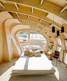 The Fab Lab House by IAAC is a breakthrough in the integration of solar systems. It features an organic shape, some hi-tech features and a very affordable construction cost.  Read more: http://www.digsdigs.com/eco-friendly-wooden-solar-house/#ixzz1DLc5yFTX
